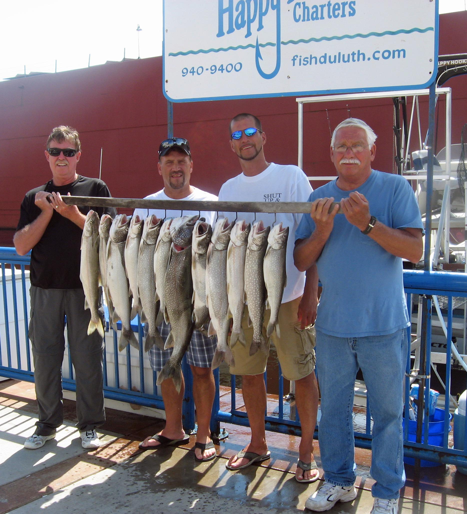 Fishermen with their limit of lake trout